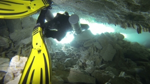 Exiting through restriction at Caterpillar cenote