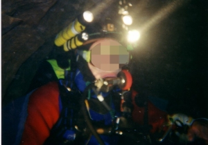 French Cave Diver uses a helmet to carry his lights